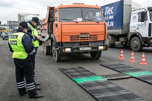 Размер штрафа за перегруз грузовой машины.